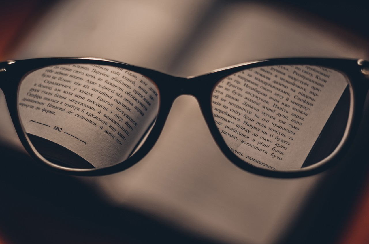 Glasses with text in focus
