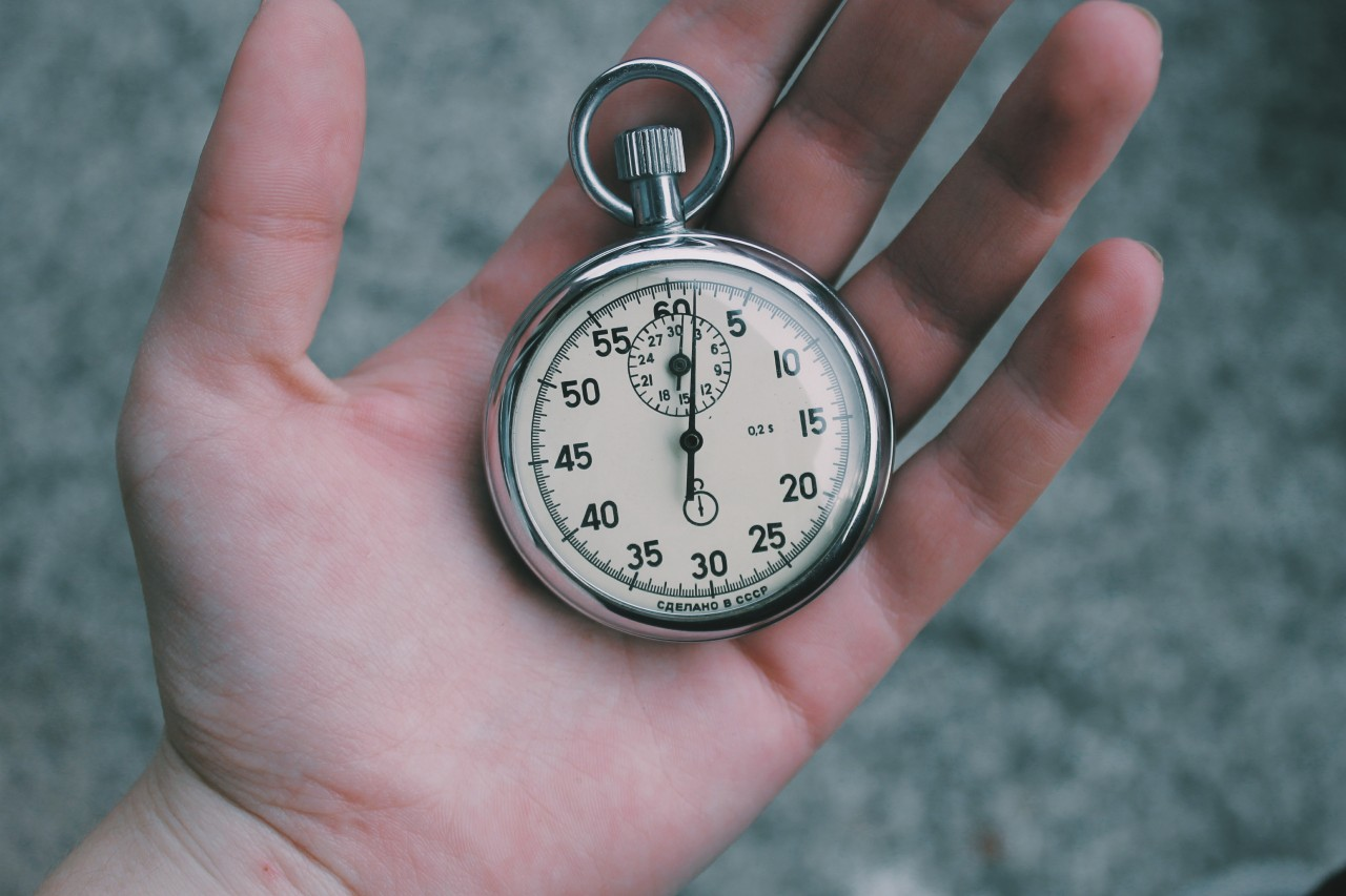 Hand holding pocket watch