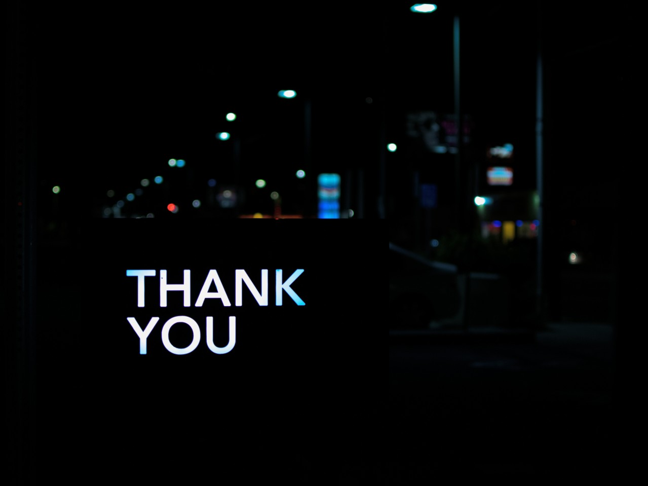thank you written against dark city background