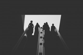 Figures on escalator